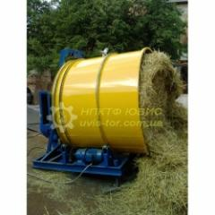 Grinder of bales of straw with an added table