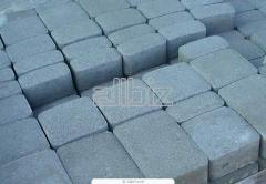 The stone blocks is sidewalk. Paving slabs. Paving