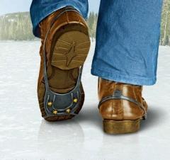 Накладки на взуття для ходьби по снігу і льоду