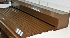 Защитные коричневые роллеты с электроприводом