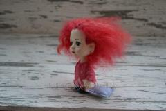 Collectible Doll Little Sonya with a pillow