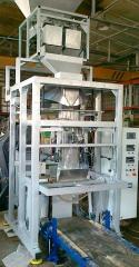 The automatic machine for packaging in plastic