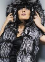 Vests from fur with a hood