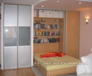 Bed a transformer built in a sliding wardrobe