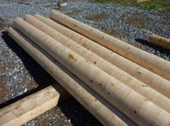 Wooden rod posts. Columns for the high voltage