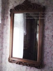 Mirror from the massif with woodcarving