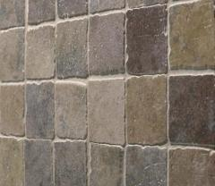 Tile facing of a natural stone
