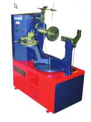 The machine for straightening of cast disks, the Equipment for car service