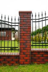 Hats on fence columns brick