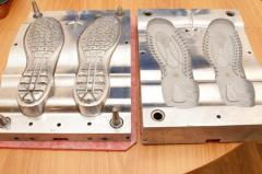 Compression molds for molding of soles for