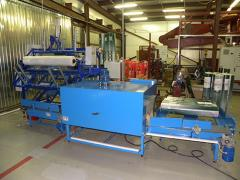 The automatic transfer line for packaging of rolls