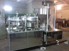 Automatic machine for can filling by mea