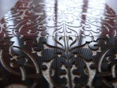 Engraving on porcelain tile, ceramics, a stone