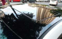 Glossy film of black color (A roof under a