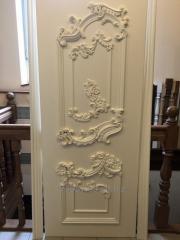 Doors wooden carved under the order.