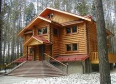 Construction of wooden country houses, cottages,