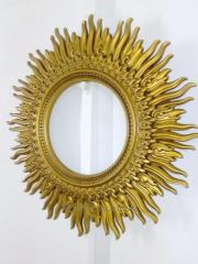Carved mirror Sun