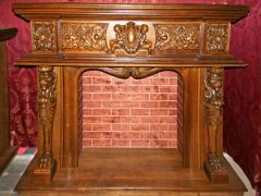 Fireplace wooden carved under an electrofire