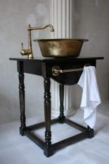 Brass wash basin.