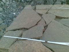 Stone sandstone gray-brown. Sandstone beige