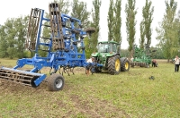 Cultivators for preseeding processing of soil of
