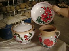 The ware is a potter's, glazed, subglaze lis