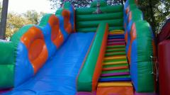 Inflatable hill trampoline with Wheelbarrows