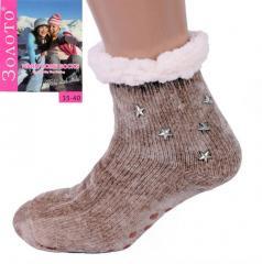 Светло-коричневые тапочки-носки со звездами...