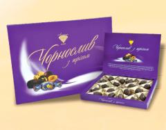 Candies in decorative boxes, Prunes with a n