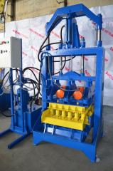 VP-1000P's vibrating press for production of