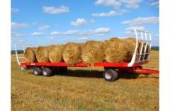 Прицеп Metal-Fach T009 грузовой ёмкостью 11,4 т. Сельскохозяйственная платформа для транспортировки рулонов.