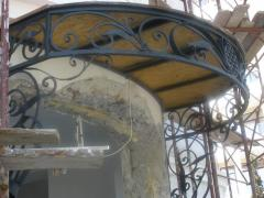 Hood over an entrance to the house