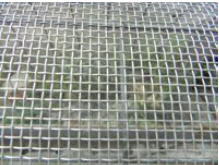 Grid woven of a corrosion-proof wire for