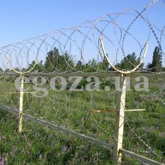 The spiral barrier of safety - Kontsertin's 700/7 SBB, from a barbed wire of Kontsertin, diameter is 700 mm, on seven brackets