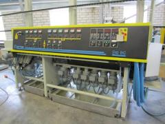 The machine for processing of an edge of glass