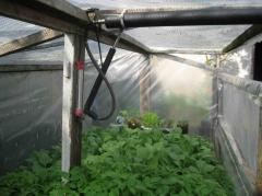 Automatic machine for airing of greenhouses