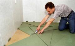 Coverings under a laminate, floor coverings