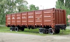 Transportation by freight gondola cars. Gondola