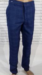 Модные мужские брюки синие в клетку