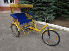 Trishaw with a back arrangement of passengers or