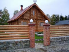 Wooden fences from logs