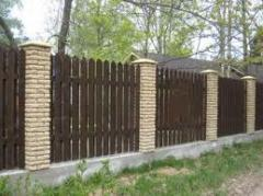 Wooden fences from not cut board