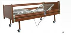 Bed wooden functional with the electric drive