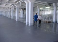 Polymeric covering for bulk floors of
