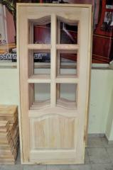 Cloth door of a pine under a glazing