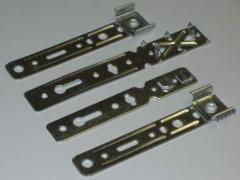 Fixture for fastening of plastic doors, windows,