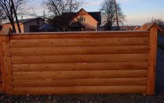 Деревянные заборы из бревен