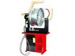 Machine for the straightening of alloy wheels