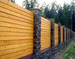 Wooden fences from logs. Wooden fences from logs