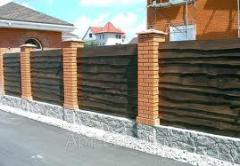 Wooden fences from not cut board.